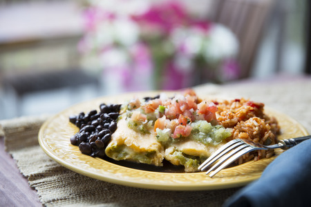 gallo: Vegetarian tamale dinner with black beans and rice topped with pico de gallo and salsa verde.