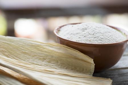 husks: Corn masa flour and corn husks for preparing tamales.