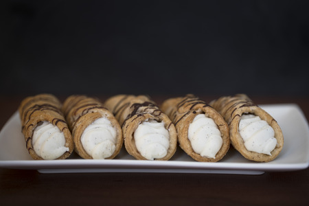 filled roll: Pastries Stuffed with sweet cream and drizzled with chocolate.