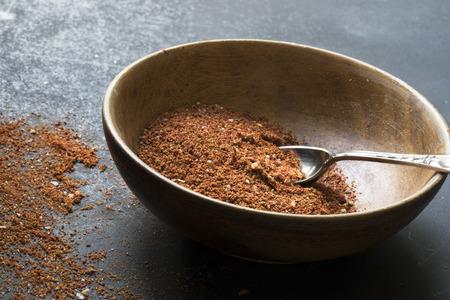 Wooden bowl with homemade taco season Foto de archivo