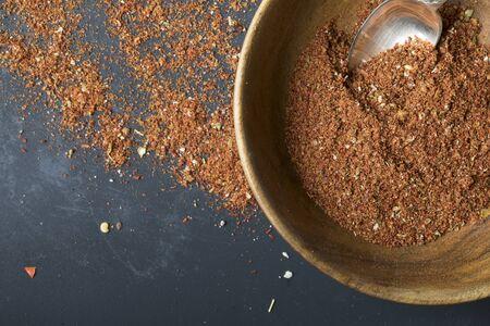 Wooden bowl with homemade taco season Imagens