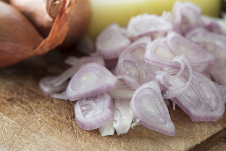 Sliced fresh shallots on a cutting board