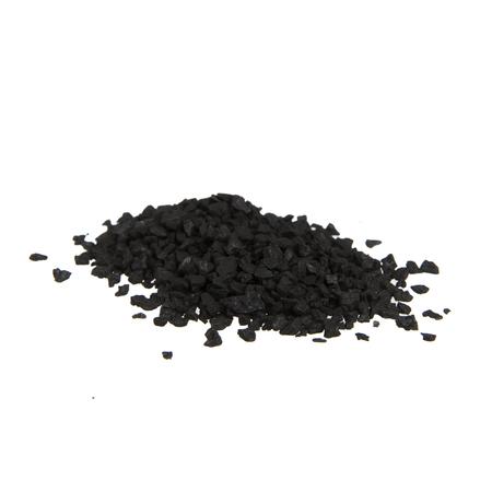 Pile of black salt isolated on white. Imagens