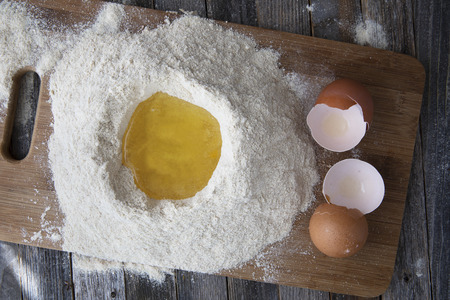 Egg whites in flour with egg shells on the side.