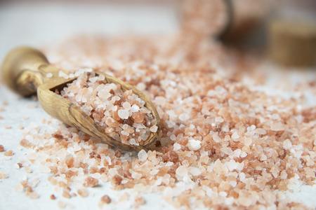 Pink Himilayan salt in wooden scoop