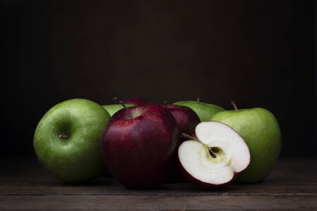 Red and Green Apples with dark background. Standard-Bild