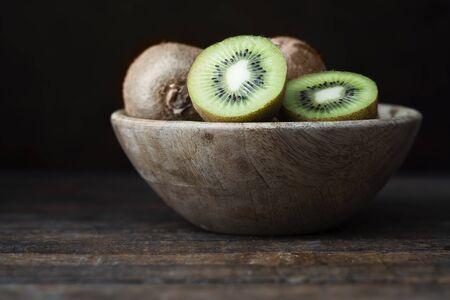 Kiwis in Wooden Bowl
