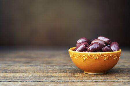 Bowl of Kalamata Olives on the table.