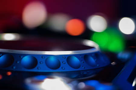 Dj mixes the track in the nightclub at a party. depth of field. closeup. Stok Fotoğraf