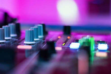 Dj mixes the track in the nightclub at a party. depth of field. closeup. Imagens