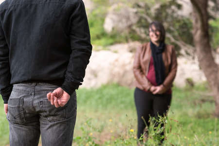 Engagement Photos, rings visible on the hands in the nature. focused rings. blurred background.