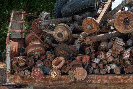 Rusted Old Axles, Spare Parts of vehicle, selective focus. Background. Horizontal. Front view