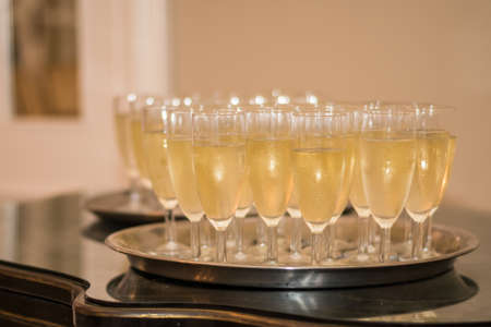 Champagne welcoming glasses on a tray on a table for party celebrations