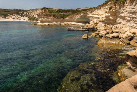 Landscape Around Marsascala Malta Cliffs, arch, crystal clear Mediterranean water around st thomas bay. side and above view. Serenity, tranquility. while tracking during winter with fresh  air. 版權商用圖片