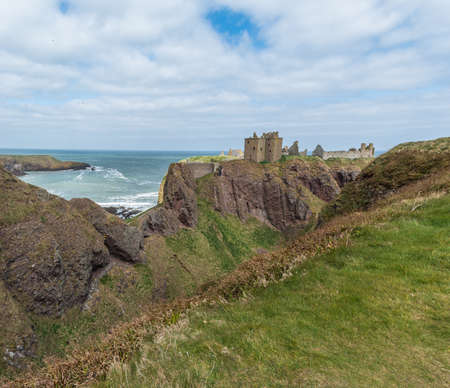 Dunnottar fortress or castle. Highlands of Scotland in spring time, bad weather during spring season Stock Photo