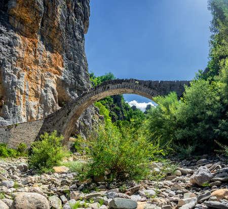 The Noutsou bridge (or Kokkori, as it is also known), a single arch stone bridge, is located in central Zagori, between the villages of Koukouli, Dilofo and Kipoi, Vikos Gorge, Greece