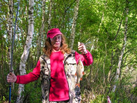 by catch: Pescador con un ret�n Foto de archivo