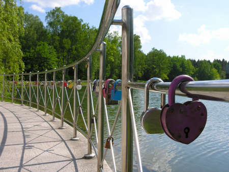 clave sol: Wedding tradition - to seal the union lock on the fence embankment
