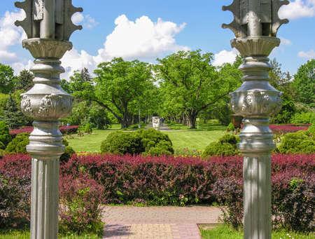 summerhouse: Minsk, Belarus - May 27, 2016: View of the ground floor of the botanical garden summerhouse, columns inside the park gazebo overlooking the alley, Minsk Botanical Garden