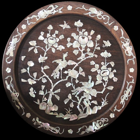 mother of pearl: Antique mother of pearl wooden disc from an antique chair back Stock Photo