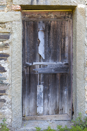 mud house: A ramshackle door Stock Photo