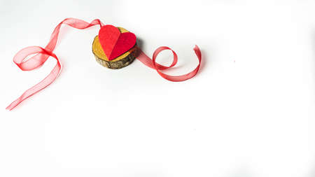 Valentine, handmade heart on wood with ribbons. isolated white background