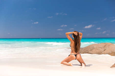 hot girl at white sand at the seychelles