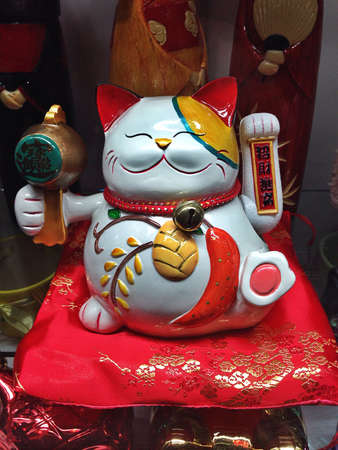 maneki: This is the lucky cat. Zhaocai Mao in China or Maneki Neko in Japan. It is an emblem for wealth and fortune Stock Photo