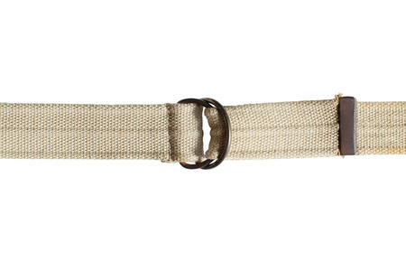 Light brown fabric canvas belt isolated on white  photo