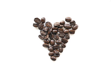 Coffee bean heart shape isolated on white background photo