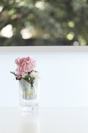 Cute pink flower on table with lighting photo