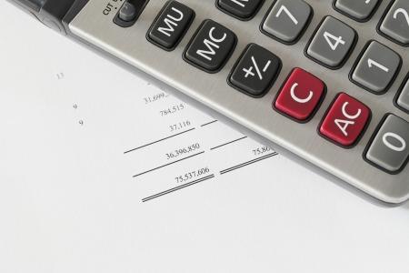 Calculator on finance statement photo