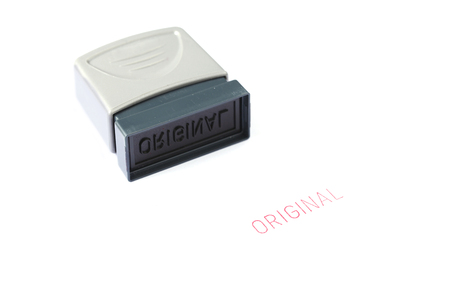 Original rubber stamp isolated on white background photo
