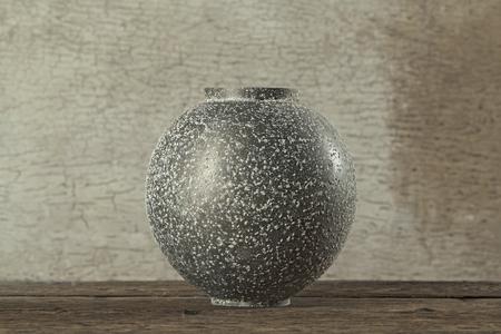 bronze bowl: Antique bronze bowl on wooden crack pattern background  Still life  Stock Photo