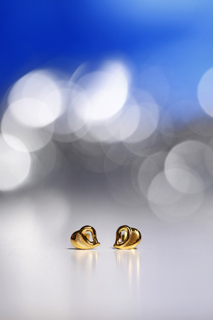 Golden heart earring gift Stock Photo - 24627854