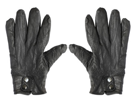 Black leather gloves isolated on white background photo