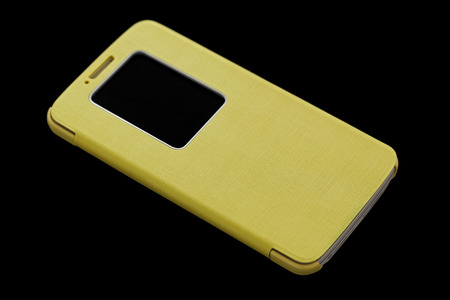 Yellow smart phone concept on dark background photo
