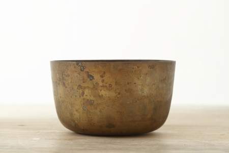 bronze bowl: Old brass bowl on wooden table