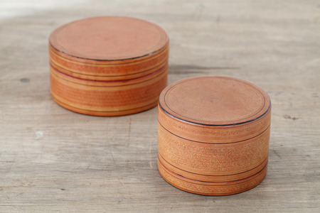 lacquer ware: Antique lacquer wares on wooden table Stock Photo