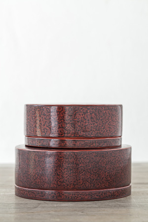 wares: Antique lacquer wares on wooden table Stock Photo