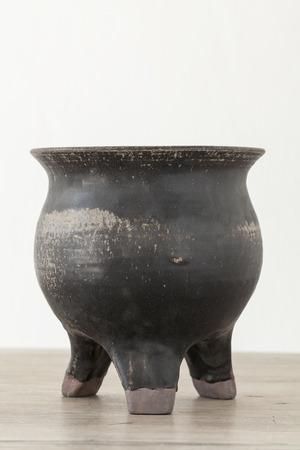 Antique ceramic jar on wooden table photo