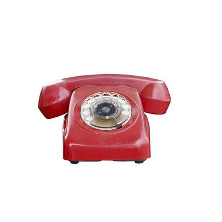 Vintage red telephone isolated on white background photo
