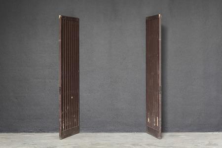 Antique wooden doors on dark concrete photo