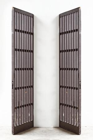 Antique wooden doors on white concrete photo