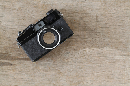 Vintage camera on wooden table photo