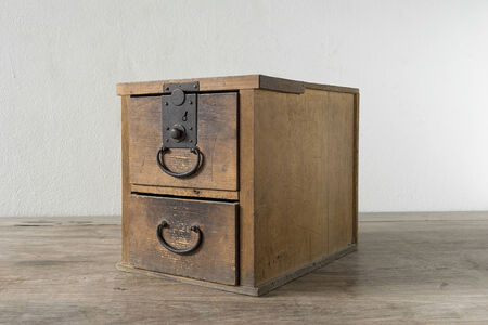 Small tansu isolated on wooden table photo