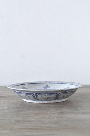 Antique ceramic bowl on wooden table photo