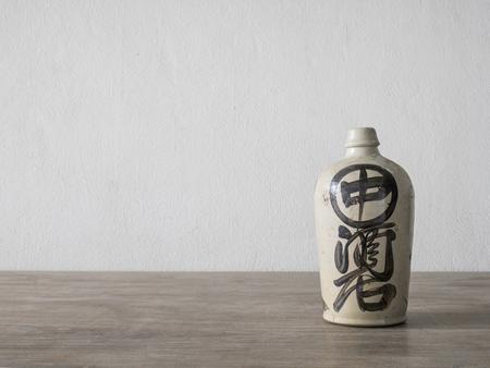 Antique ceramic jar on wood table photo