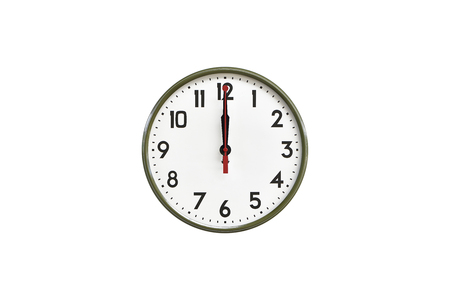 morning noon and night: Green wall clock.Twelve oclock Stock Photo