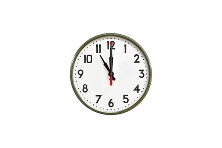 morning noon and night: Green wall clock.Eleven oclock Stock Photo